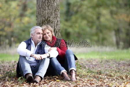 couple sat by tree