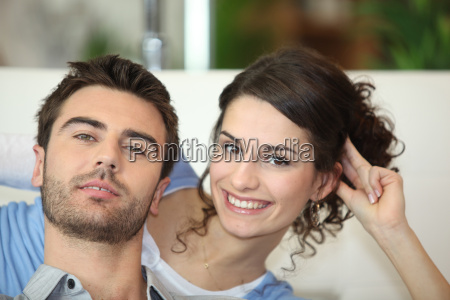 couple sat watching television