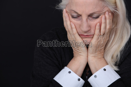 senior woman looking sad and lonely