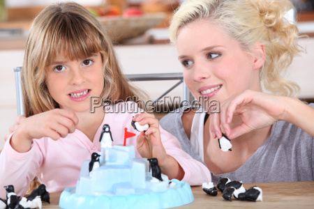 woman and little girl playing with