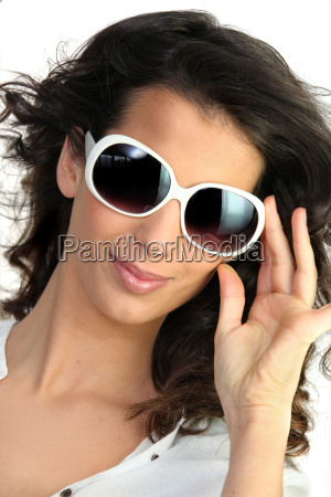 young woman in oversized sunglasses