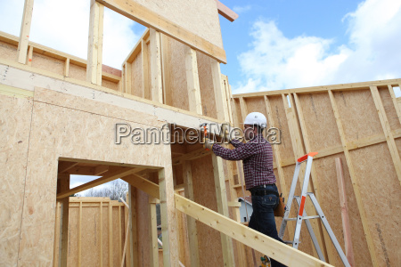 carpenter at work in construction site
