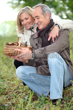old couple watching a wickerwork basket