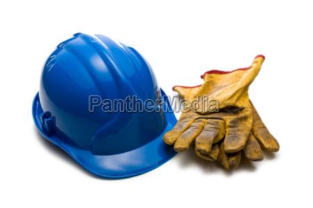 blauen schutzhelm und arbeitshandschuhe leder