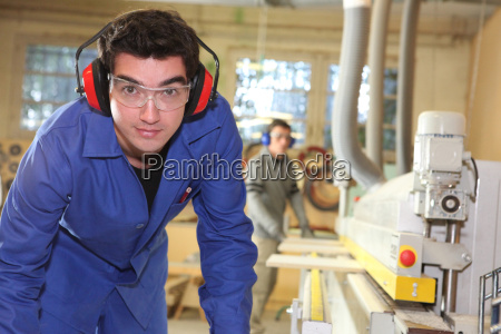 apprentice working in a factory