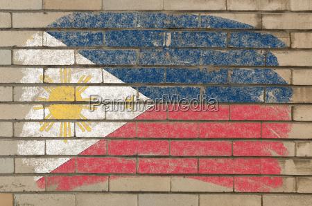 flagge von phillipinen auf grunge ziegelwand