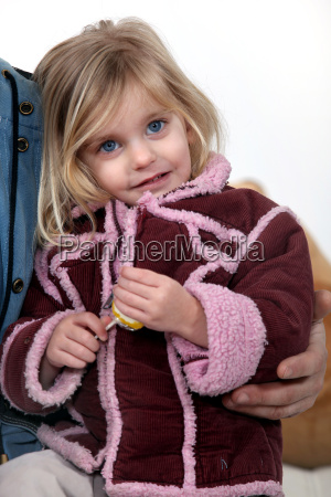 young girl wearing a coat and