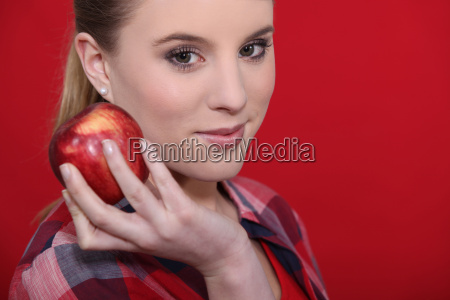attractive woman holding a red apple