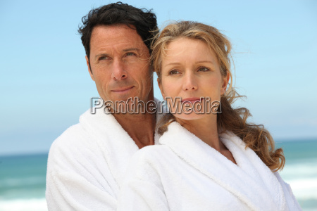 couple on the beach in white
