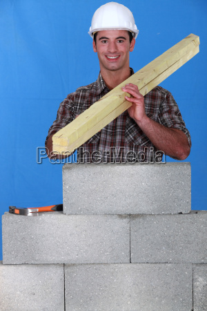 craftsman working with wood and stone