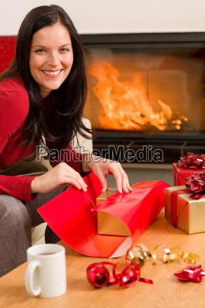 christmas wrap present happy woman home