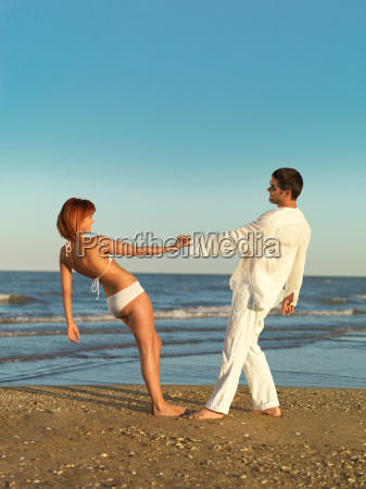 happy young couple by the sea