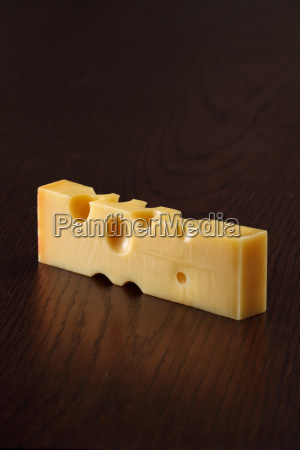 swiss cheese on a table