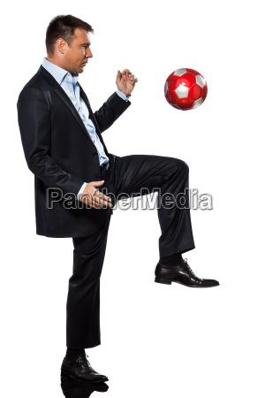 one business man playing juggling soccer