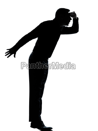 one business man silhouette tiptoe looking