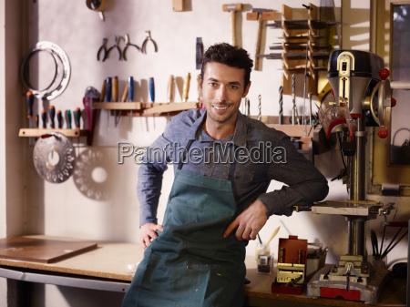 happy italian artisan at work smiling