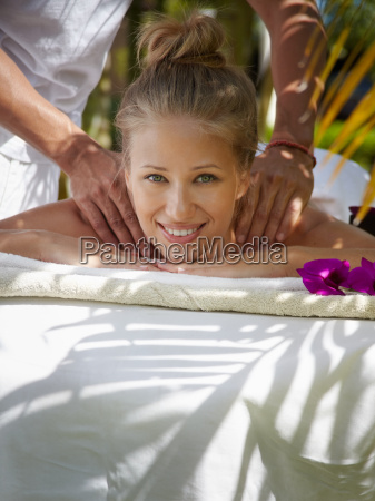 happy young woman smiling during massage