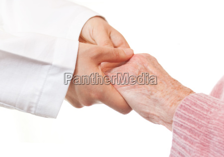 doctor holding senior lady039s hands