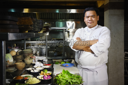 asian chef smiling at camera in