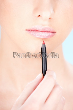 cosmetic pencil near woman039s lips