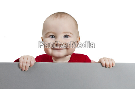 young child holding shield