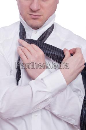 hands and tie