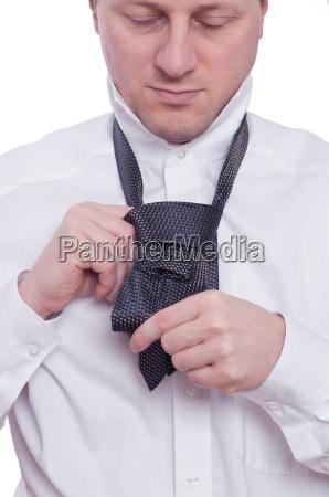 tie tie with hands