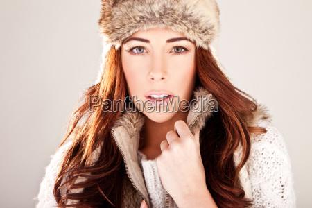 gorgeous redhead fashion model in winter