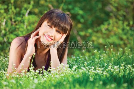 woman laying grass