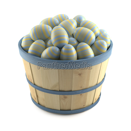 basket of striped easter eggs on