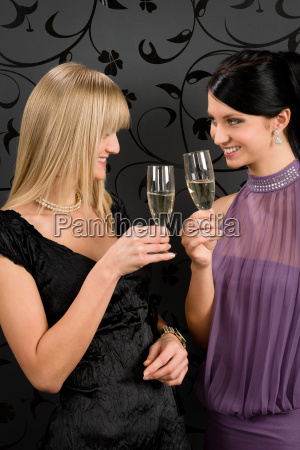 woman friends party dress toast champagne