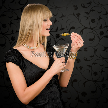 woman party dress hold cocktail eat