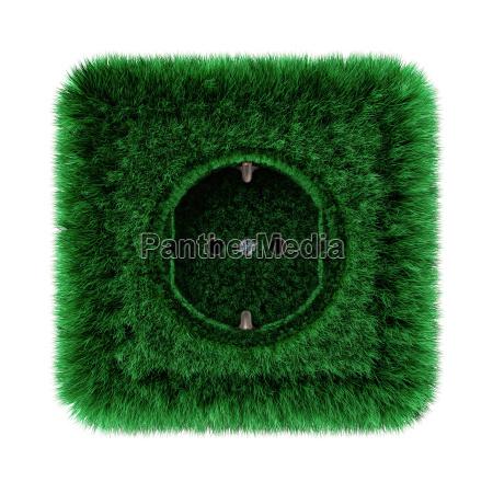 gruene steckdose mit gras bewachsen