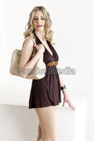 portrait of standing woman wearing summer