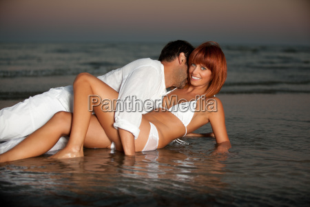 happy romantic couple by the sea