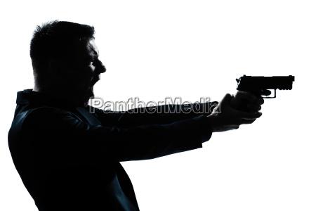schattenbildmannportrait mit gewehr