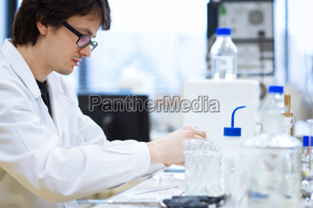 young male researche carrying out scientific