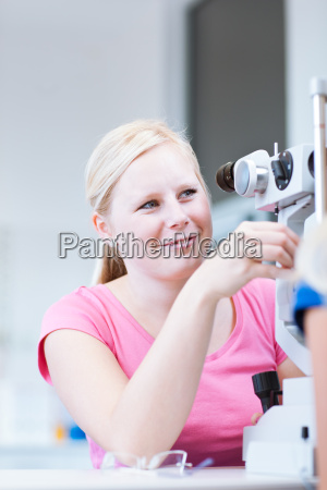 optometry concept young optometrist using