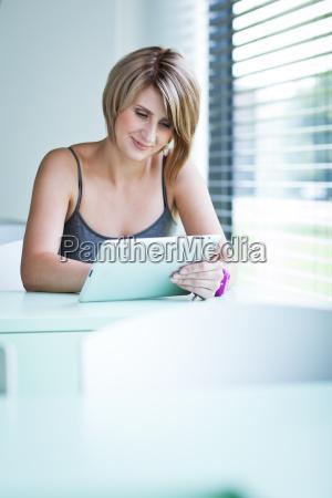 college studentbusinesswoman working on her tablet