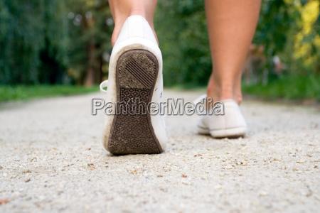 walking woman in park