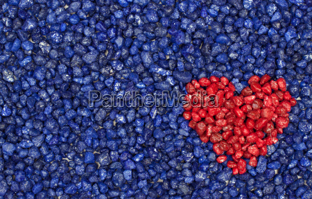 red heart on blue ground