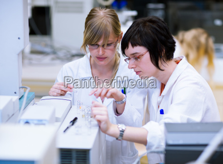 female researcherschemistry students doing research
