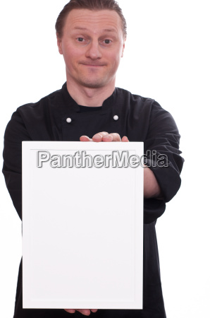 smiling chef holding white picture frames