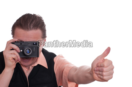 man with camera viewfinder holding thumbs