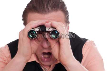 man looks surprised through binoculars
