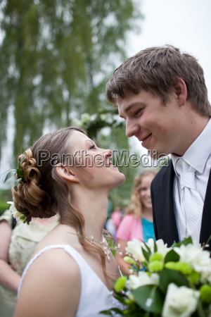 young wedding couple posing outdoors