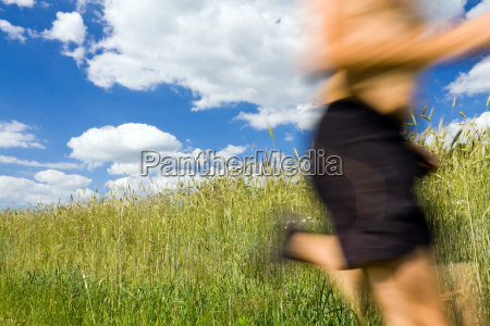 man cross country running on trail