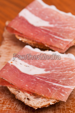 two sandwiches with raw ham