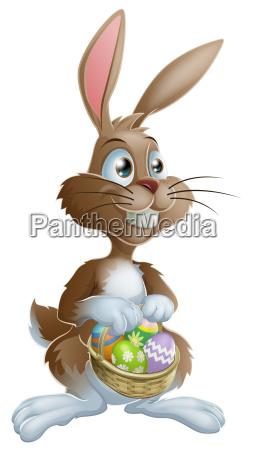 easter bunny rabbit holding easter eggs