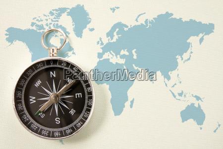 black compass on blue world map
